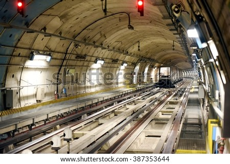 A new generation of metro train drive alone without driver. A subway travelling in an underground tunnel - stock photo