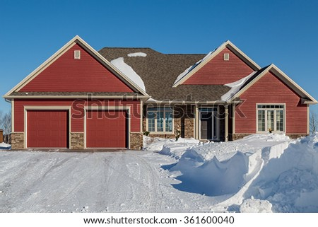 A new home on a sunny winter day. - stock photo