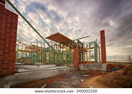 A new house being constructed out of timber - stock photo