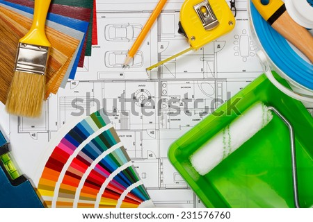 A new house painting, choosing colors for walls - stock photo