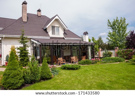 A new house with a garden in a rural area