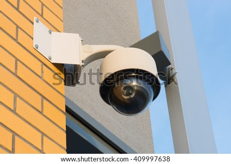 a new monitoring camera on the new building - stock photo