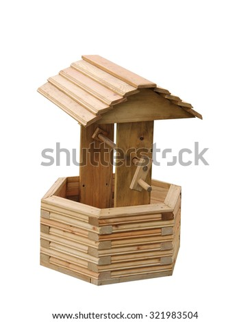 A New Ornamental Wooden Garden Wishing Well. - stock photo