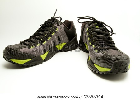 A new pair of hiking shoes on a white isolated background - stock photo