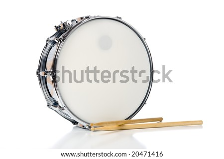 A new silver snare drum with sticks on a white background - stock photo