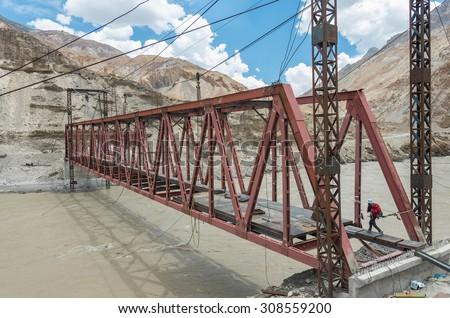 a new steel bridge over the Zanksar river under construction. this bridge will shorten the way to the Markha valley. Ladakh, Jammu and Kashmir - India
