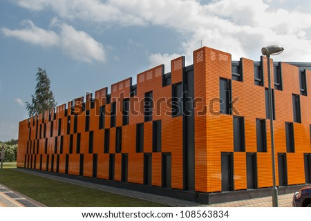 a new warehouse was built from colorful metal panels - stock photo