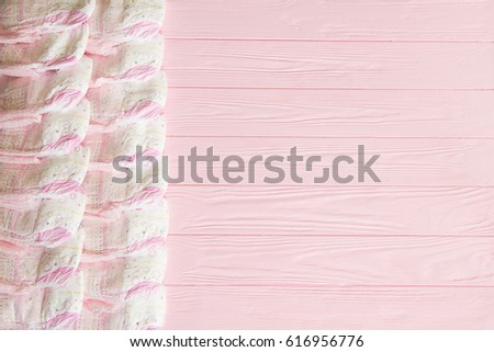 A Newborn Baby Girl Background. Pink Diapers For A Baby Girl On A Pink  Wooden