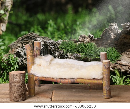 A newborn bed studio digital prop made from a Japanese Maple tree branch with a fairy nature background.