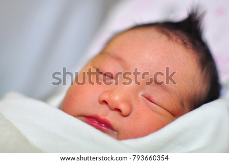 A newborn child in the hospital