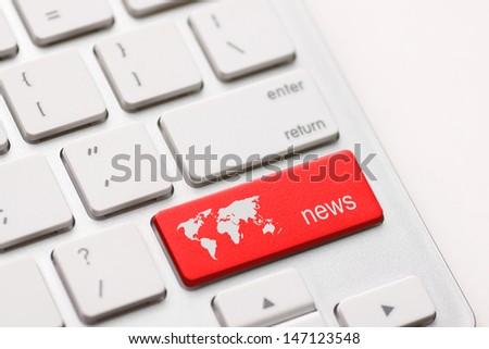 A news key button on laptop white keyboard - stock photo