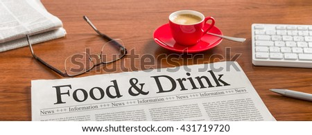 A newspaper on a wooden desk - Food and Drink - stock photo