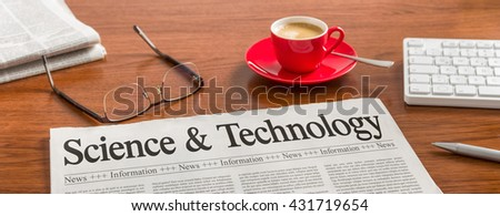 A newspaper on a wooden desk - Science and Technology - stock photo