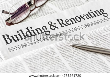 A newspaper with the headline Building and Renovating - stock photo