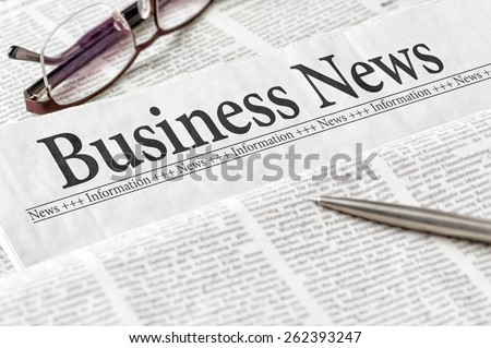A newspaper with the headline Business News