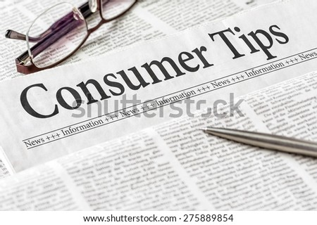 A newspaper with the headline Consumer Tips - stock photo