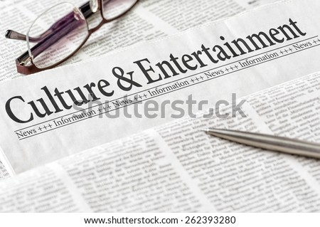 A newspaper with the headline Culture and Entertainment - stock photo