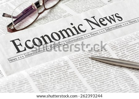 A newspaper with the headline Economic News