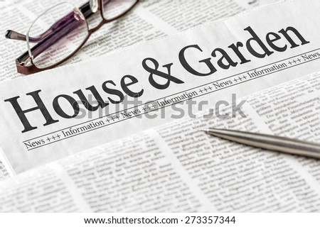 A newspaper with the headline House and Garden - stock photo