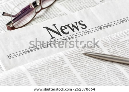 A newspaper with the headline News - stock photo