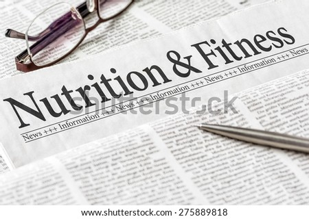 A newspaper with the headline Nutrition and Fitness - stock photo