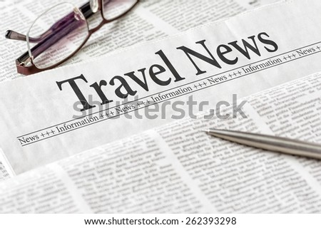 A newspaper with the headline Travel News - stock photo