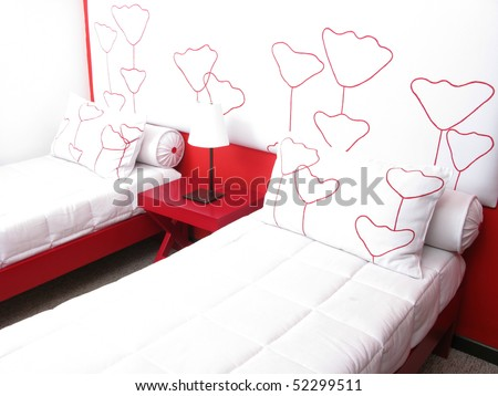 A nice bedroom with two beds and lamp - stock photo