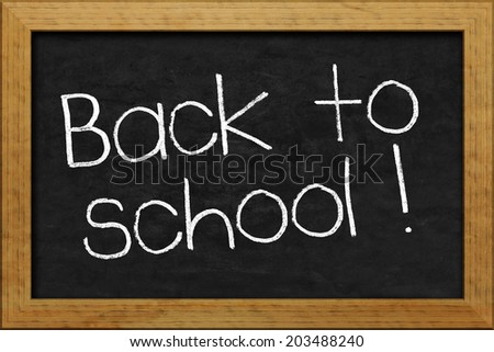 A nice black chalkboard with text back to school