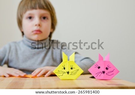 A nice boy with a paper Hares - stock photo