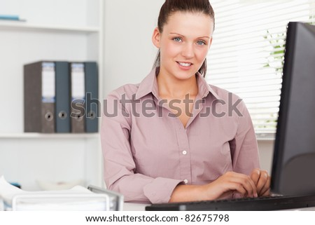 A nice businesswoman sitting in her office