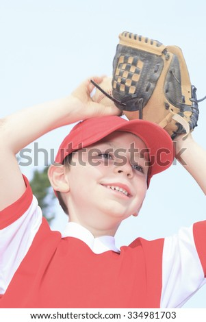 A nice child happy to play baseball