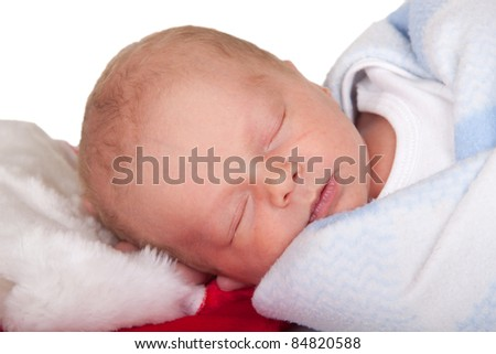 A nice Christmas image of a two week old infant.