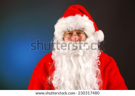 A Nice Classic Santa Claus Portrait on a Christmas Green background. Santa Claus is loved by both children and adults around the world and is a family tradition to have him visit on christmas eve. - stock photo