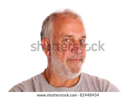 A nice close up portrait of an older serious doctor with a white beard.  He has a nice look in his eyes. - stock photo