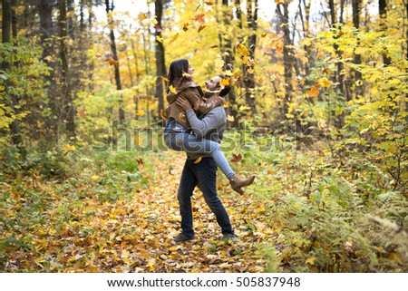 A Nice couple having fun in autumn park