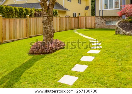 A nice entrance of a house over outdoor landscape - stock photo