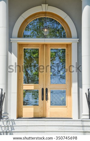 A nice entrance of a luxury house over doorsteps. - stock photo