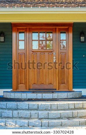 A nice entrance of a luxury house over outdoor landscape. - stock photo