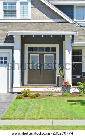 A nice entrance of a luxury house with street pavement in front - stock photo