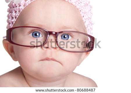 A nice image of a cute but serious baby.  This baby is getting ready to study for preschool.