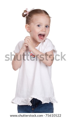 A nice photograph of a cute young girl who is very excited.