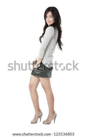 A nice pose of a lovely model in a full length image
