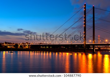 A night bridge over the Rein river in Dusseldorf. GPS information is in the file - stock photo