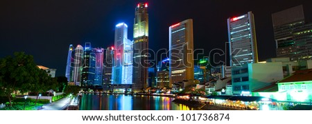 A night panorama of city with skyscrapers (the business part of Singapore) - stock photo