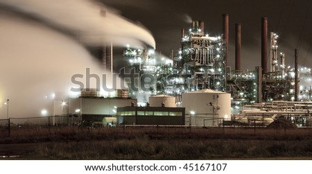 A night view of an petrochemical industrial area - stock photo