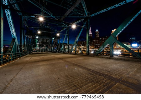 A night view of the Cleveland, Ohio skyline from the road deck of the abandoned Eagle Street lift bridge.
