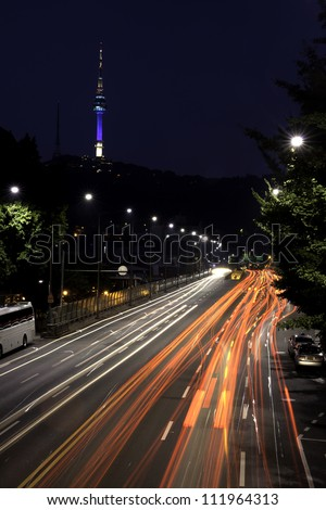 A nighttime long exposure shot of downtown Seoul area around Namsan tower.