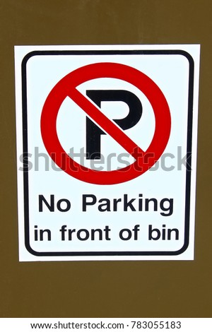 A no parking in front of garbage bin sign.