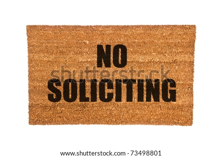 A no soliciting doormat isolated on a white background - stock photo