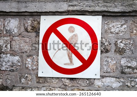 A no urinating sign. - stock photo